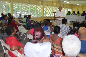 Minister of Communities, Ronald Bulkan interacting with residents of East La Penitence