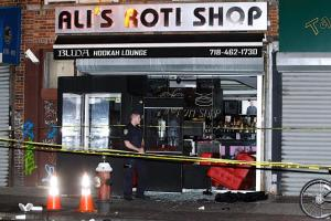 The shooting took place inside Ali's Roti Shop in Flatbush, Brooklyn, police said