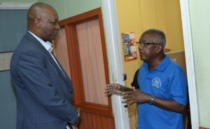 Minister Harmon and General Manager, Godfrey Proctor. [Jules Gibson Photo]