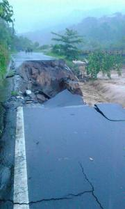 The road to Layou Village has collapsed. It is adjacent to the Layou River.