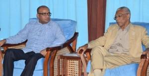 Opposition Leader, Bharrat Jagdeo (left) and President David Granger.