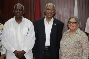 President David Granger (center) flanked by Robeson Benn (left) and Bibi Shadick, following the swearing in ceremony.