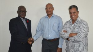 Minister of Citizenship, Winston Felix shaking hands with Edward Heerenveen, Chief General and International Affairs Manager of InselAir. Also in picture is Local Representative for InselAir, Captain Gerald Gouveia.