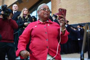 Pat Cabell, of Brooklyn, cries as the casket of slain New York Police Department officer Randolph Holder arrives at the Greater Allen A.M.E. Cathedral on Oct. 27, 2015 in Queens, New York.