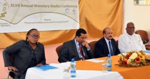 L-R: Tracey Gibson, Dave Seeratan - OiC Caribbean Centre for Money and Finance, Dr Gobind Ganga, Head of Bank of Guyana and Finance Minister, Winston Jordan