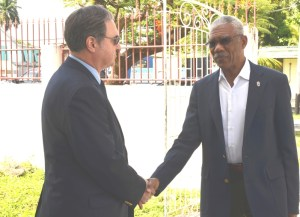 President David Granger being greeted by Russian Ambassador to Guyana, Nikolay Smirnov outside the French Consulate on Peter Rose Street where they both signed the Book of Condolence