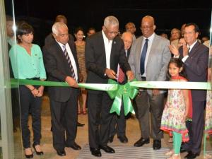 resident Granger and Finance Minister Winston Jordan participating in the symbolic ribbon cutting ceremony in the presence of the Bank's Chairman, Dr. Yesu Persaud, CEO, Pravinchandra Dave and Board member, Mr. Hemraj Kissoon.