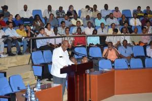 Minister of Finance Winston Jordan delivering remarks at the Procurement Symposium