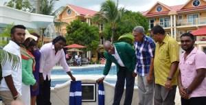 Minister of State, Joseph Harmon and Developer of the resort, Chunilall Baboolall declare the resort open
