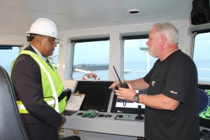 Minister of Governance Mr. Raphael Trotman pays keen attention as the Captain of the Fugro Americas explains the vessel's capabilities.