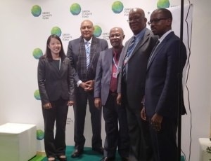 Minister Trotman (second from left) with the team from Global Green Initiative after the signing.