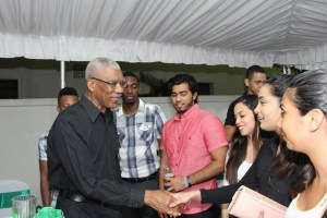 A group of young students meeting the President