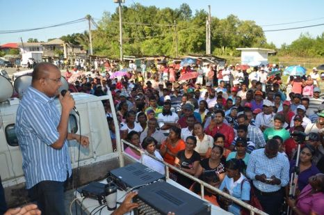 Opposition Leader Bharrat Jagdeo addressing a large gathering of sugar workers, and residents of the Wales community on Tuesday afternoon (Carl Croker photo)