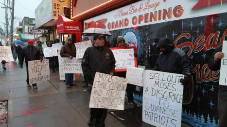 Scores of New York-based Guyanese  braved the cold to protest Moses Nagamootoo yesterday