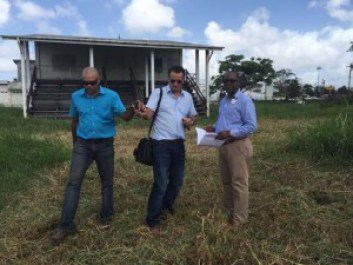 GFF's Second Vice-president, Rawlston Adams (right), with representatives of one of the bidders