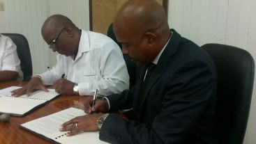 CEO of the CDF, Rodinald Soomer and Guyana's Minister of Finance, Winston Jordan, as they signed a supplementary loan agreement for Guyana's CAP in the CDF's first funding cycle