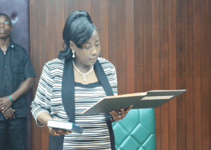 Newly sworn in Minister within the Ministry of Communities with responsibilities for the housing sector, Valerie Patterson taking the Oath of Office today
