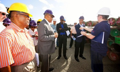 Minister of Natural Resources, Mr. Raphael Trotman; Minister of Public Infrastructure, Mr. David Patterson;  Minister of Business, Mr. Dominic Gaskin; and other representatives pay keen attention to an ExxonMobil's representative, during a tour of the oil company's storage facility at the Wieting & Richter Wharf