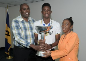 Allrounder Shamar Springer shares the World Cup trophy with his parents