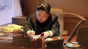 Kim Jong-un is shown signing-off on the rocket launch