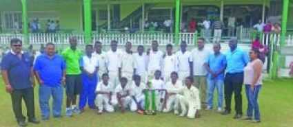 The victorious Demerara Under-15 players pose with the winner's trophy, along with sponsor Dave Narine (far left) and president of GCB Drubahadur (second left)