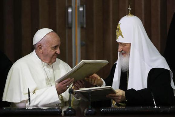 Pope Francis, left, and Russian Orthodox Patriarch Kirill exchange a joint declaration on religious unity in Havana, Cuba, 12, February 2016. Pope Francis and the leader of the Russian Orthodox Church, Patriarch Kirill, held a historic meeting in Havana's international airport. The two leaders signed a memorandum, which focused on ecumenism, or efforts to reunite Christian churches, common Christian values, and the persecution of Christians in the Middle East and Africa. Source: EPA