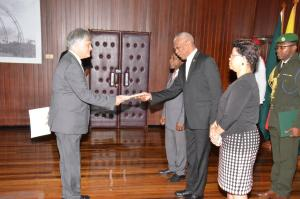 High Commissioner of the Commonwealth of Australia to Guyana, His Excellency John Pilbeam presents his Letters of Credence to President David Granger, while Minister of Foreign Affairs, Mr. Carl Greenidge (pictured on the President's right) and Director General, Ministry of Foreign Affairs, Mrs. Audrey Waddell (right) look on, at the Ministry of the Presidency.