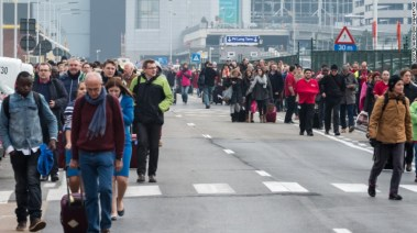 Passengers outside the Brussels airport this morning