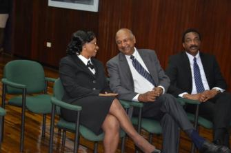 Chief Justice Yonette Cummings-Edwards shares a light moment with Chancellor of the Judiciary Carl Singh, in the presence of Attorney General Basil Williams (Carl Croker photos)