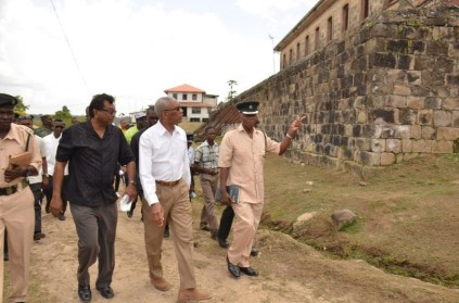 President David Granger and Minister of Public Security, Mr. Khemraj Ramjattan being led on a tour of the Mazaruni Penal Settlement by Officer in Charge Mr. Alexander Hopkinson.