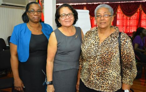 First Lady, Mrs. Sandra Granger is flanked by, (left) Mrs. Colleen Cameron, Health and Family Life Education (HFLE) Coordinator and Mrs. Evelyn Hamilton (right), Chief Planning Officer, both of the Ministry of Education.