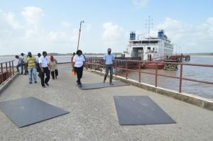Minister within the Ministry of Public Infrastructure, Annette Ferguson along with a group of engineers inspecting the Supenaam stelling