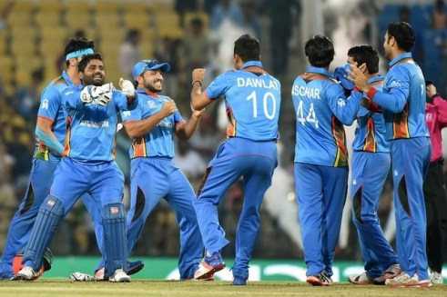 Afghanistan's players celebrate after winning the World T20 cricket tournament match against West Indies at The Vidarbha Cricket Association Stadium in Nagpur on March 27, 2016. Punit Paranjpe / AFP