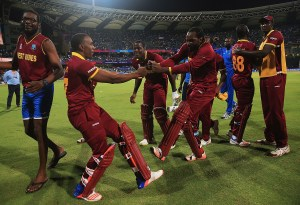 Dwayne Bravo and Chris Gayle showcase their moves after West Indies won the semi-final match during the ICC World Twenty20 India 2016 Semi-Final match between West Indies and India at the Wankhede Stadium on March 31, 2016 in Mumbai, India.