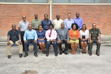 Minister of State, Mr.  Joseph Harmon (seated fourth from right) and members of the board of Directors of the Guyana Lands and Surveys Commission in the Commission's compound at D'urban Backlands