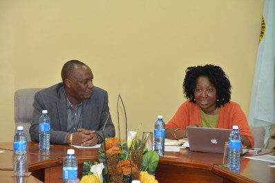 Minister of State, Mr.  Joseph Harmon listens as new Chairperson of the Board of Directors of the Guyana Lands and Surveys Commission Ms. Paulette Henry makes a point, during a meeting this afternoon.