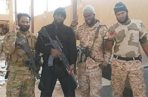 Trinidadian fighters Shane Crawford, from left, Arshad Mohammed and three other unidentified Trinidadians pose for a photo last year. Crawford has since been killed. TT Guardian Photo)