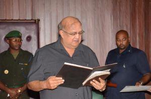 Dr. Carl Hanoman taking his Oath to Office before President David Granger