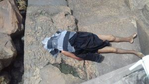 The lifeless body of Ramesh Ramdeen at the seawall yesterday afternoon