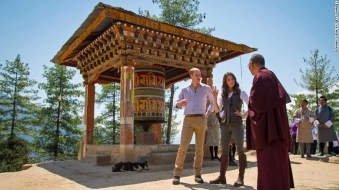 Britain's Prince William and his wife Catherine, the Duchess of Cambridge, chat with a monk in Thimphu, Bhutan, on Friday, April 15. Hide Caption