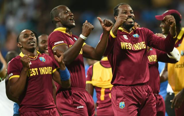 """From left to right: Dwayne Bravo, Darren Sammy and Chris Gayle do the """"Champion Dance"""" after their win over India in the World T20 semifinal. (AFP)"""
