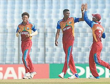 Fast bowler Alzarri Joseph, centre, celebrates a wicket with captain Shimron Hetmyer, right, during the ICC U-19 World Cup. The pair will feature in this year's CPL tournament. Photo: courtesy ICC