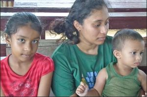 Wife of the deceased Devika Tejnarine, 27, and the couple's two children