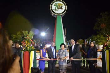 RIBBON CUTTING: President Granger and First Lady Sandra Granger and Minister Dominic Gaskin during the ribbon-cutting ceremony to officially open GuyExpo 2016