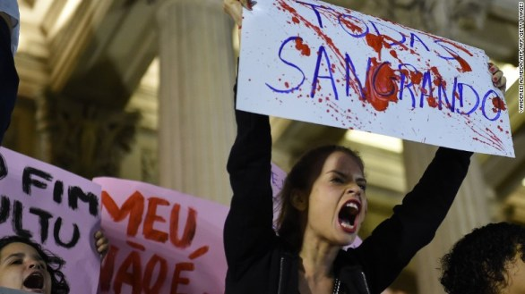 Brazilians protest in front of the Legislative Assembly of Rio de Janeiro on May 27, 2016, against a gang-rape of a 16-year-old girl.