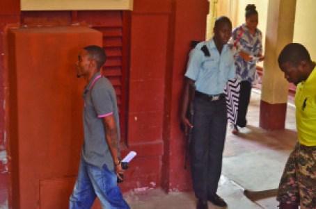 Jailed: Lorrick Williams (gray shirt) and Chris Douglas (yellow shirt) Guyana Times photo