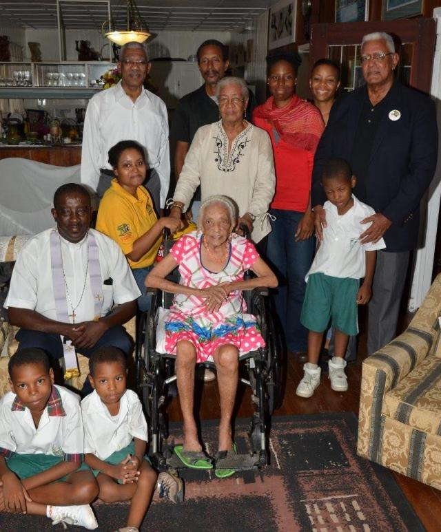 President David Granger (left, backrow) celebrates with Ms. Ina Holder and her relatives.  Minister of Agriculture, Mr. Noel Holder is pictured at right