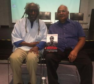 Eusi Kwayana and P. D. Sharma, the owner of Carib House, who published the book