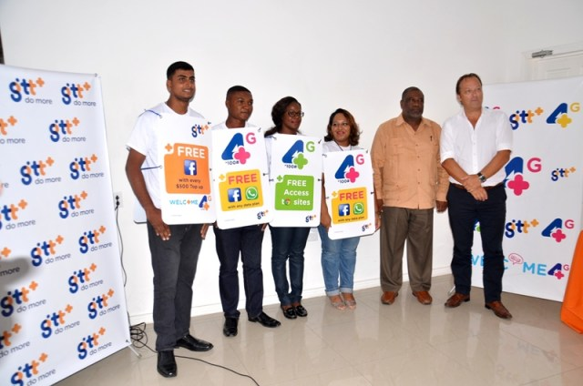 GTT Chief Commercial Officer Gert Post (right), Permanent Secretary of the Telecommunications Ministry Derrick Cummings (second right) along with GTT models at the launch