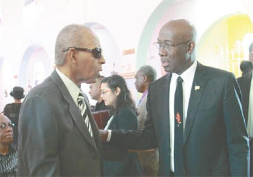 Flashback February 2016, Prime Minister Dr Keith Rowley, right, greets former People's National Movement leader and prime minister Patrick Manning during the funeral service for party stalwart Winston Moore at Our Lady of Perpetual Help Catholic Church in San Fernando. (Photo: KRISTIAN DE SILVA/ Trinidad Guardian)